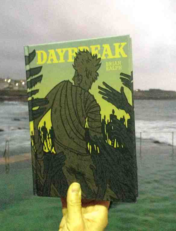 Reading Brian Ralph's Daybreak at the beach at dawn.