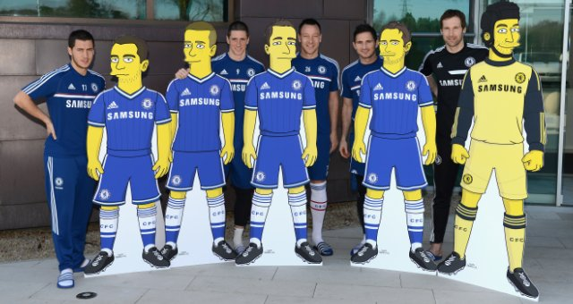 Chelsea FC players standing behind their Simpsonised characters.