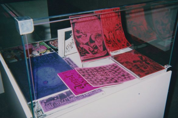 Display of Black Light Angels minicomics by Louise Graber in the exhibition.