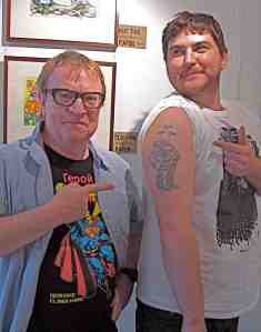 Chasing Vaughan Bodē comics-Michael Hill with Nic Beatson and Bodē tattoo. (Photo-© 2013 Louise Graber)
