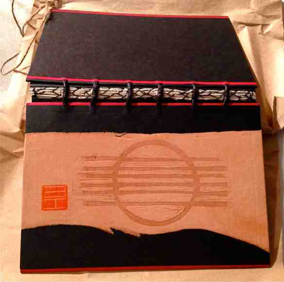 The Grafik Guitar artist book, cover and stitching, bookbinding design by Imogen Yang. (Photo-© 2013 Michael Hill).