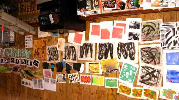 A spread of artwork on the studio floor.