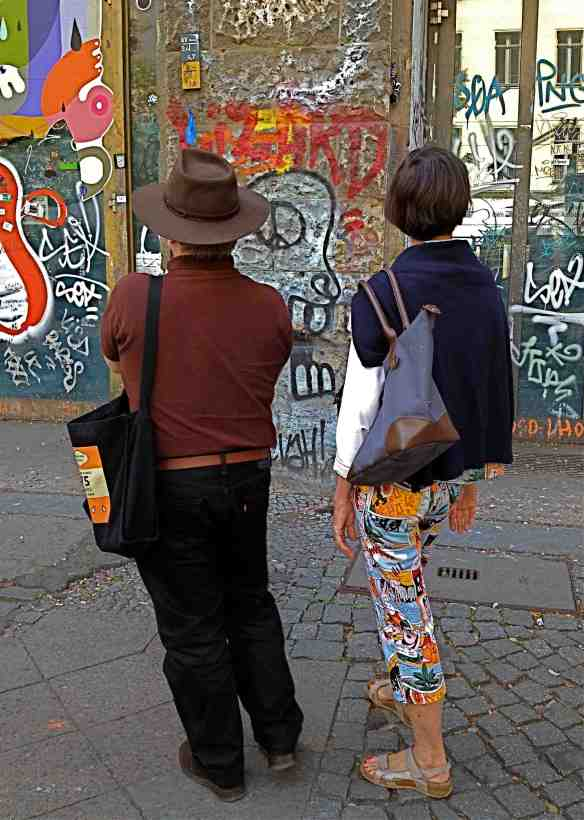Looking at street grafiks. (Photo-© 2014 Louise Graber)