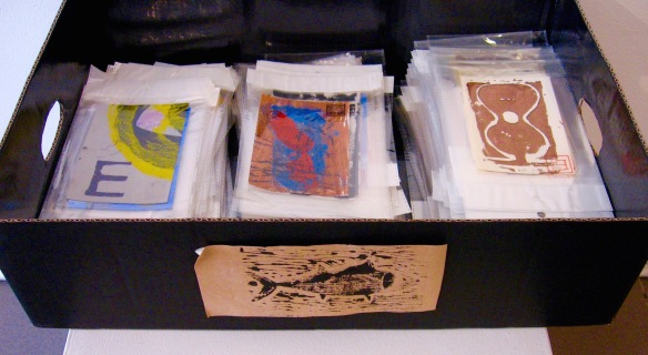 Art postcards sorted and stacked for cartage to gallery.